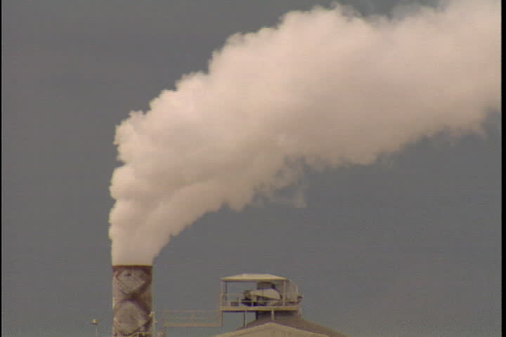 CONVENT, LOUISIANA - CIRCA SEPTEMBER 1999: Thick, white smoke spews from smokestack at Convent oil refinery.