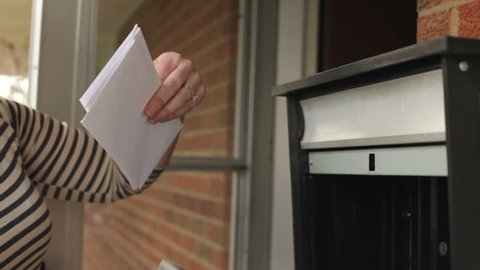 Woman getting mail smiles jib shot