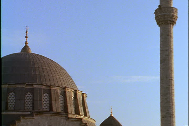 ISTANBUL - CIRCA NOVEMBER 1999: Tilt down from top of minaret to large dome of Mihrimah mosque.