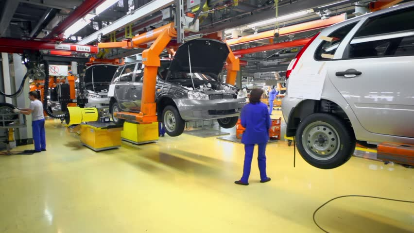 TOGLIATTI - SEP 30: Workers set wheels on car Lada Kalina on September 30, 2011 in Togliatti, Russia. In January 2013 AvtoVAZ sold 34684 cars LADA more than in January 2012 by 6%
