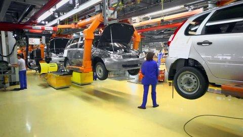 TOGLIATTI - SEP 30: Workers set wheels on car Lada Kalina on September 30, 2011 in Togliatti, Russia. In January 2013 AvtoVAZ sold 34684 cars LADA more than in January 2012 by 6%