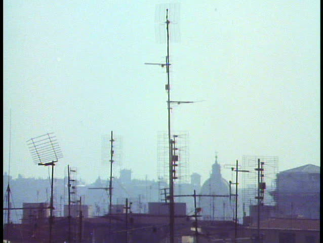Rome, Italy, Close up of aluminum antennas on roofs, backlighting