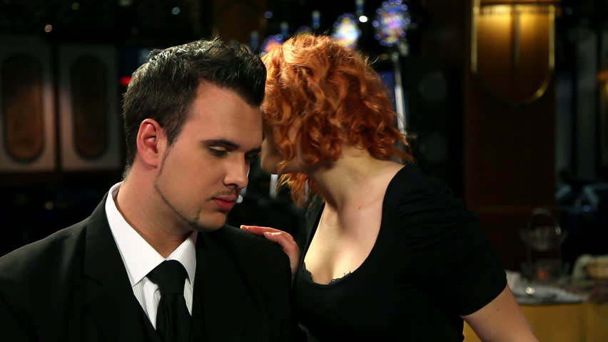 Attractive young woman whispering to a gambler | Shutterstock HD Video #3859745