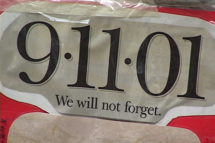 NEW YORK CITY - SEPTEMBER 29, 2001: We Will Not Forget headline left at 9/11 memorial outside Engine 23 fire station.