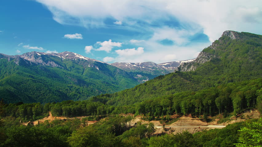 Timelapsed scenery with mountain peaks and cloudy sky   Shutterstock HD Video #3893324