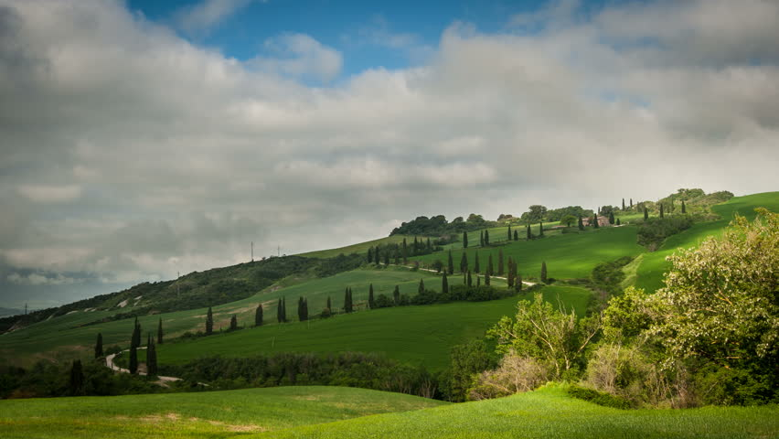 The famous winding road with cypresses from la Foce to Castelluccio, near Siena. Landscape in Val d'Orcia. Tuscany, Italy.