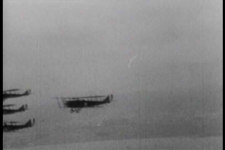 1910s - Aviator Franklin Rose commands a squadron of biplanes flying in formation in 1918.
