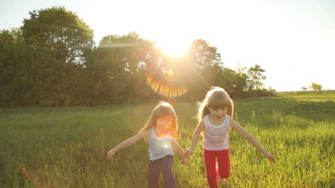 Two girls are playing catch-up with flare