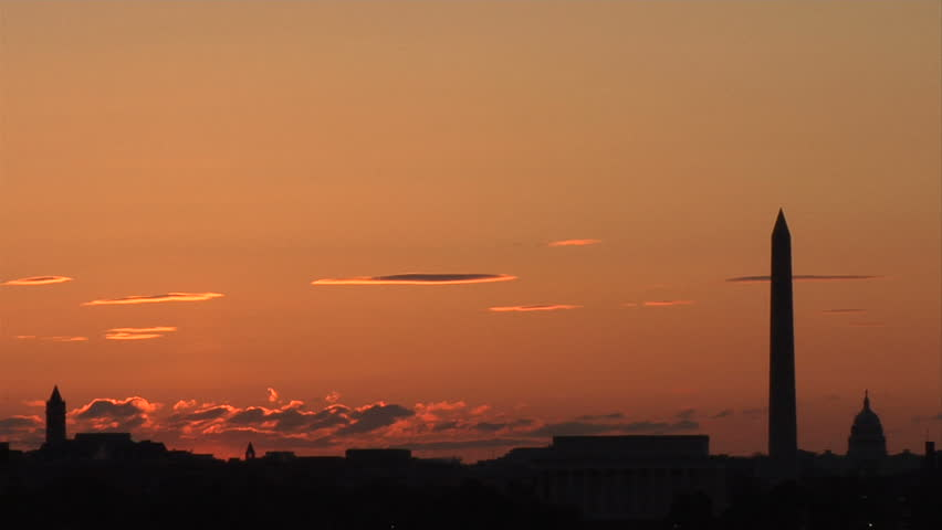 A Sunrise time-lapse over Washington DC. Monuments in silhouette line the frame bottom right.
