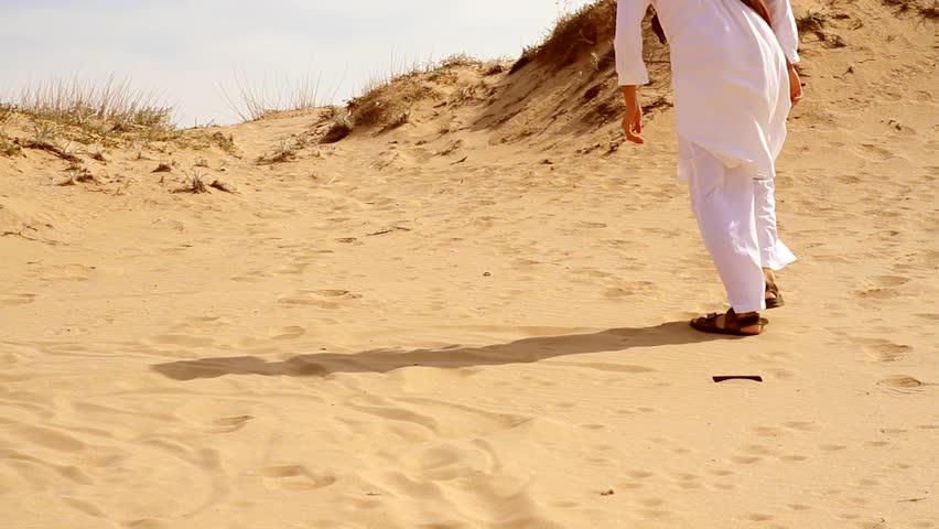 Arab Man Walking in Desert HD