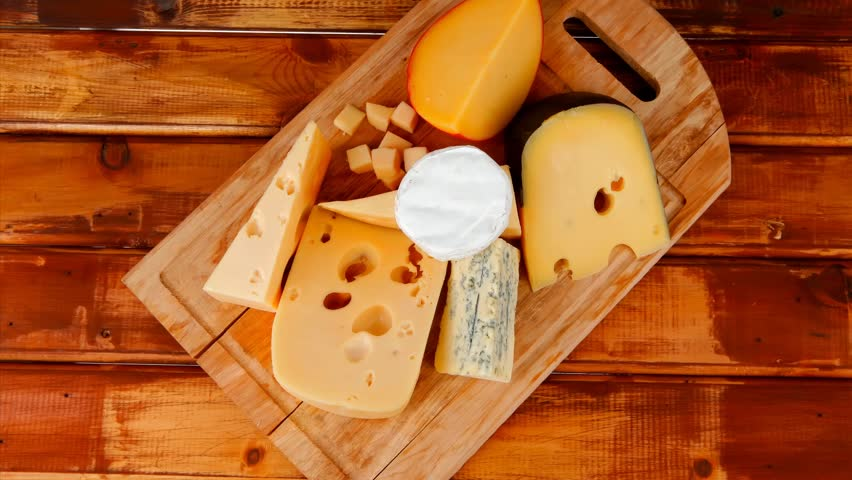 different cheeses served on wooding cutting board 1920x1080 intro motion slow hidef hd