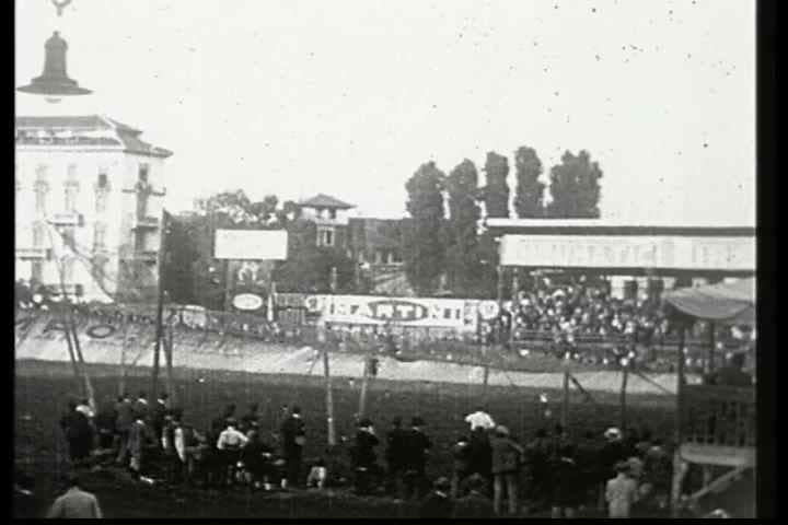 1920s - A man is shot out of a cannon and lands in a net.