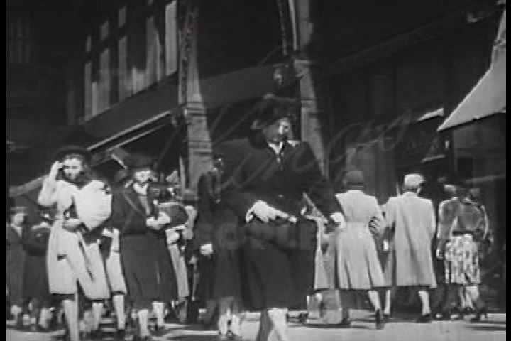 1940s - Good shots of 1940s streets and people buying and selling followed by the boss telling a salesman how to sell his products better.