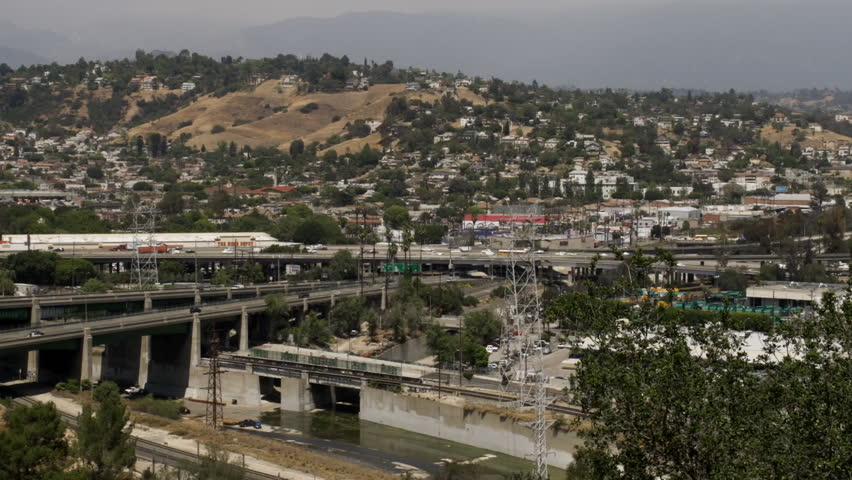 City and freeways spread over valley  | Shutterstock HD Video #3938435