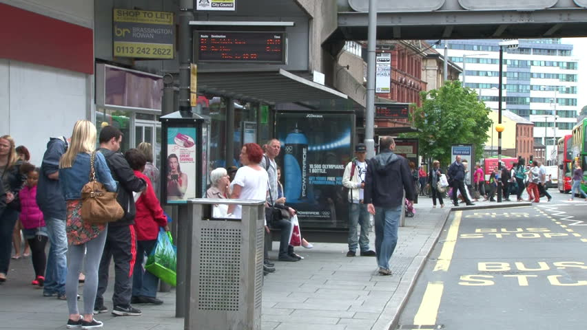 NOTTINGHAM, UK - AUGUST 2012 - Locals waiting for a bus in a modern city centre.