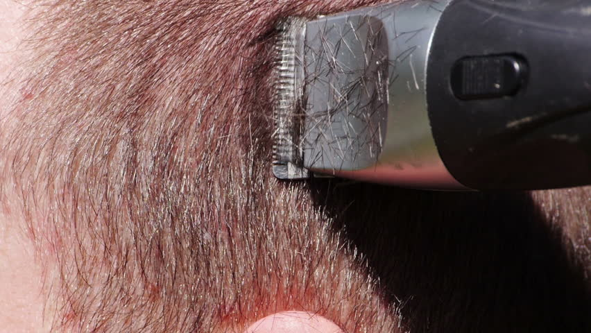Short haircut. Video close up footage of cutting hair with clipper.