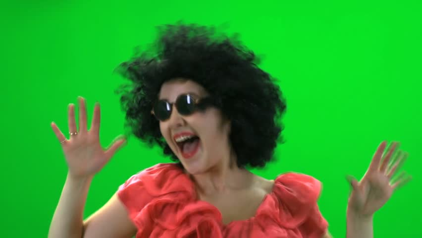 women dancing creasy against green screen. fun funny excited