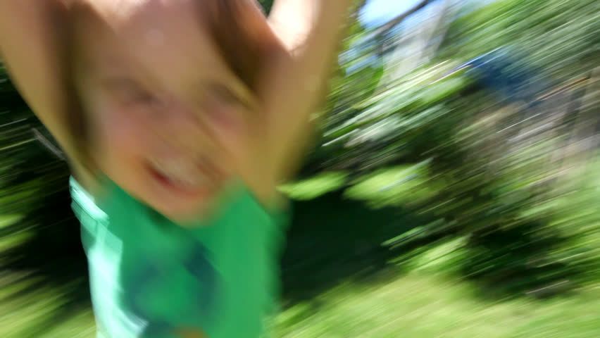 Little boy spinning around and around laughing and smiling at the end of his fathers arms on a sunny day | Shutterstock HD Video #3964747