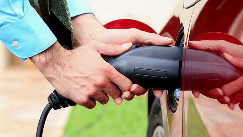 Electric vehicle being plugged in or unplugged | Shutterstock HD Video #4004512