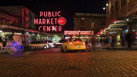 SEATTLE, WASHINGTON,  - SEPTEMBER 2: Time lapse of pedestrians and traffic at Pike Place Market at night. Pike Place Market is one of Seattle's most popular destinations. September 2, 2012
