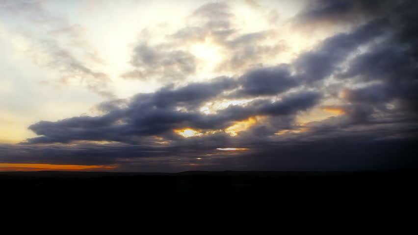 Cloudscape, A slow moving cloudscape with lighting from the rising sun.