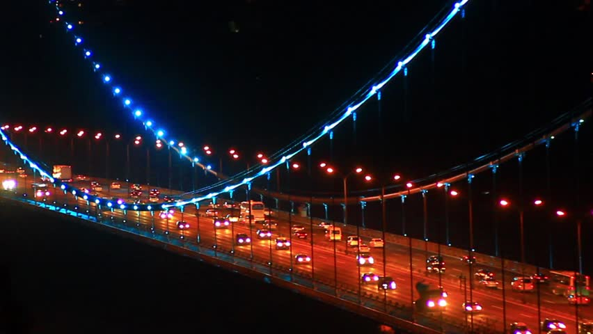 Night traffic on Trans European Motorway. Heavy traffic on suspended bridge