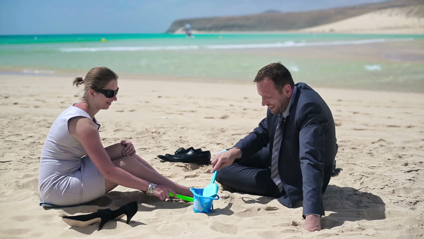 Businesscouple Playing On The Beach And Talking   HD Stock Footage Clip