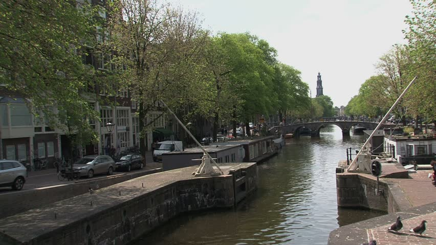 canal in amsterdam with the westertoren at the background hd stock video clip - Bamboo Garden 2016