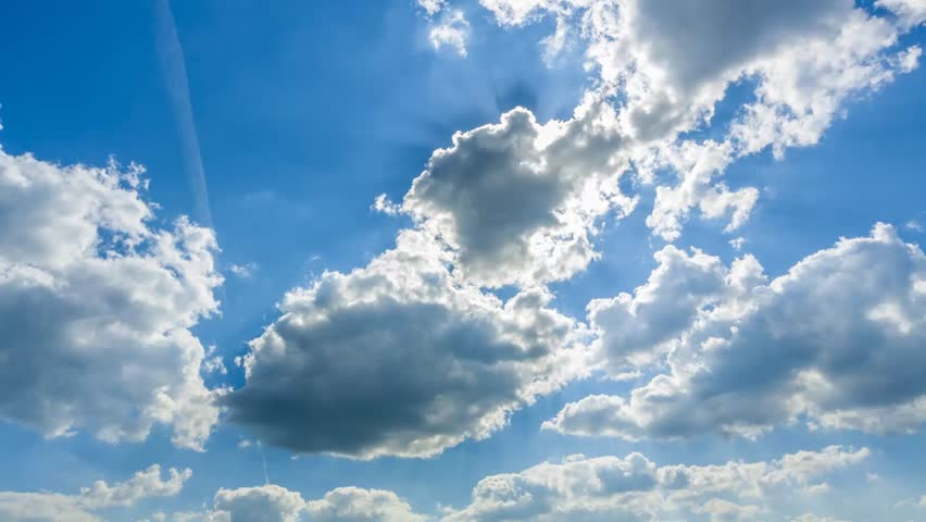 summer sky time lapse, sun veiled by moving clouds, airplane passing by