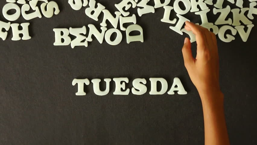 A person spelling Tuesday with Plastic letters | Shutterstock HD Video #4037665