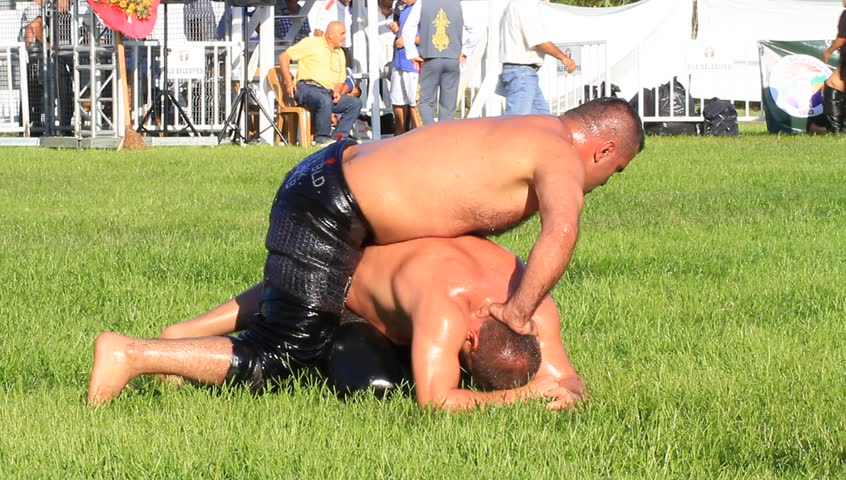 ISTANBUL - AUG 24: 8th Sile Annual Turkish Oil Wrestling Event on August 24, 2012 in Istanbul, Turkey. Oil wrestler (Pehlivan) in a tight headlock.