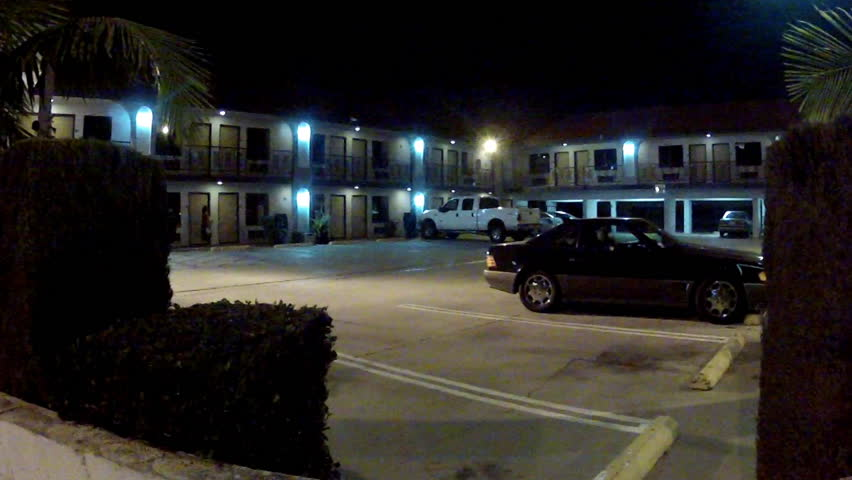 parking lot of a generic looking motel motor lodge at night circa 2013 in Long Beach. Features a look at staying at a hotel at night.