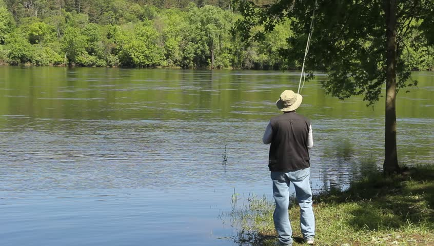 A man fly fishing in a river stock footage video 2610875 for How many fishing rods per person in texas