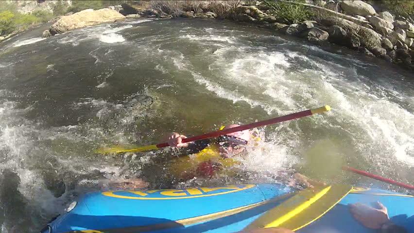 Man overboard - saved. White water rafting.