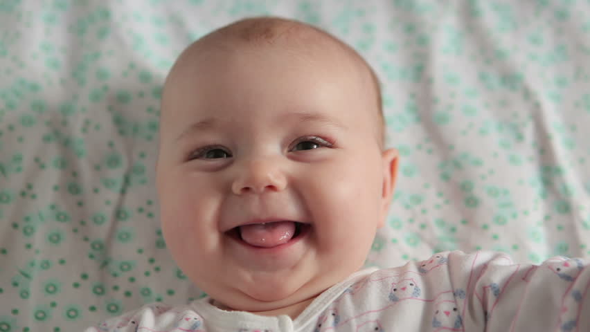Cute baby lies on back and smiling (closeup) | Shutterstock HD Video #4093909