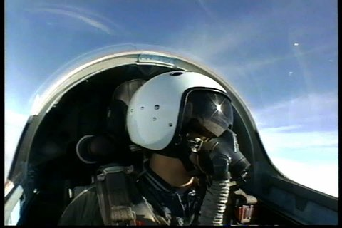 ZHUKOVSKY, RUSSIA - JANUARY 01, 1995: Head-on shot of pilot wearing mask and helmet in cockpit of Soviet military plane