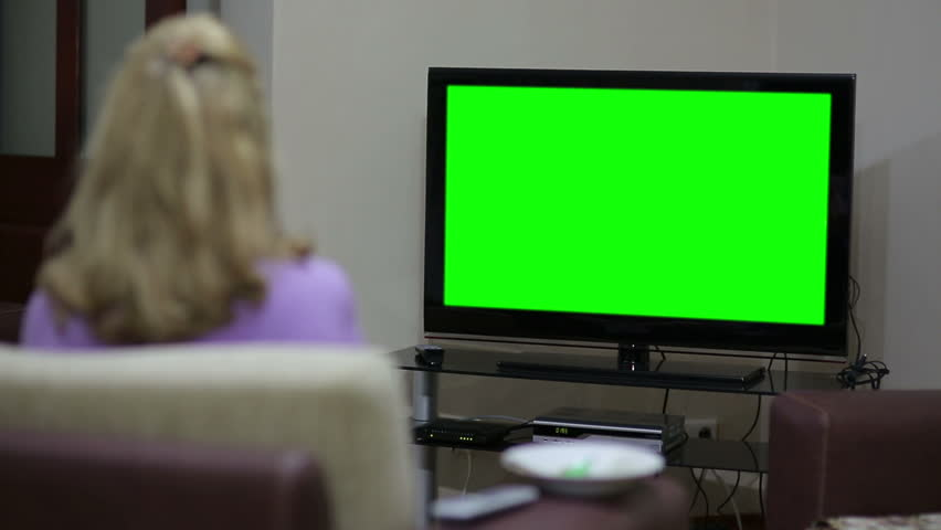 Couple sitting in front of blank green TV screen