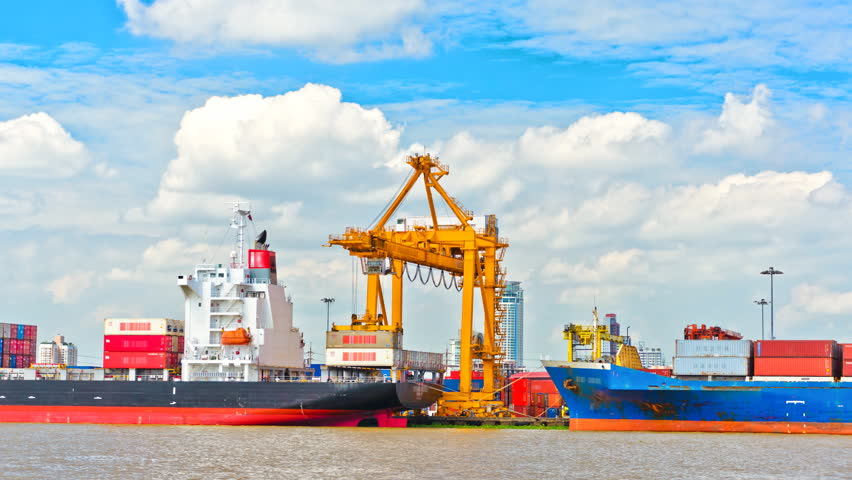 Container Cargo Freight Ship With Working Crane Bridge In Shipyard For Logistic Import Export Background Stock Footage Video 3454082