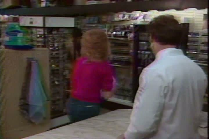 1980s - A woman receives her prescription from the pharmacist and a doctor prescribes codeine to a young man with a broken arm in the 1980s | Shutterstock HD Video #4132255