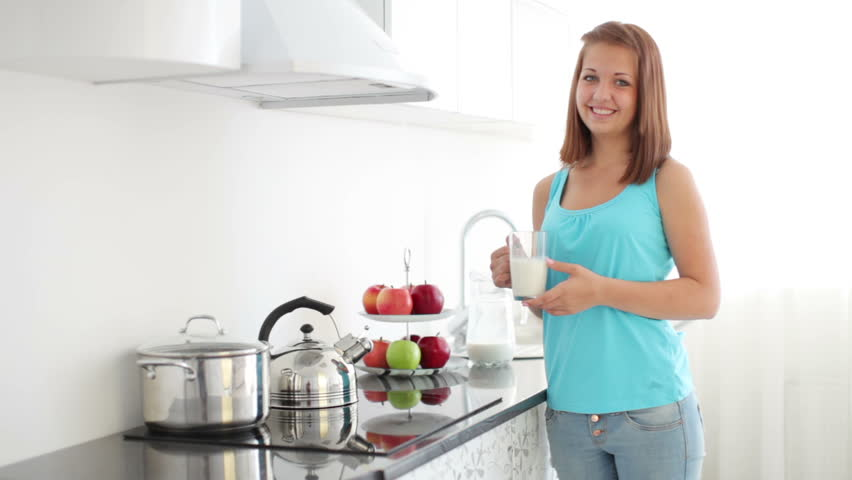 Girl Standing In Kitchen, Holding Green Apple And Laughing Stock ...