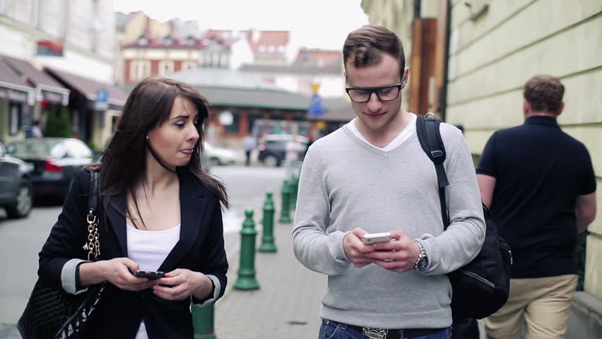 Young students with smartphone in the city