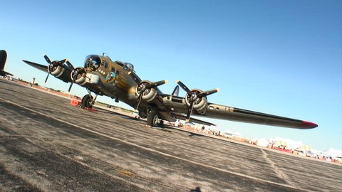 B17 Flying Fortress WWII bomber parked at an airfield.