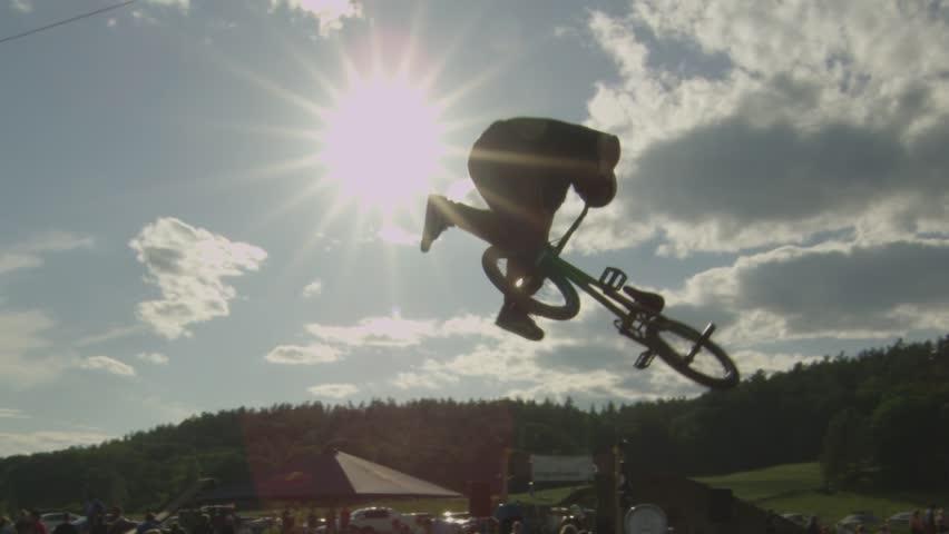 BMXer extreme sport 360 Tailwhip Trick on Dirt Jump | Shutterstock Video #4158721