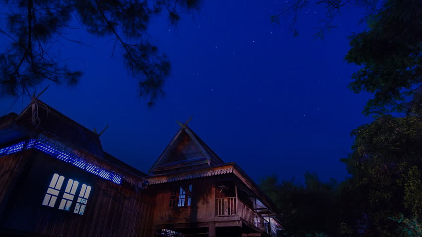 beautiful time lapse star trail and thailand ancient house