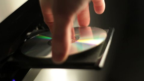 Insert and eject a cd in a player. Find similar clips in our portfolio.