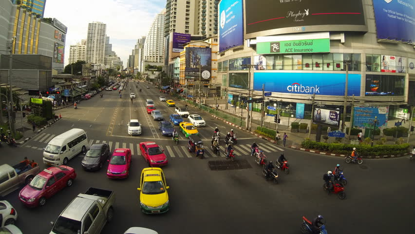 BANGKOK, 27 June: timelapse with vertical pan of traffic during the day from Asok BTS station at the  intersection of Sukhumvit and Asok Montri roads on June 27 2013 in Bangkok Thailand
