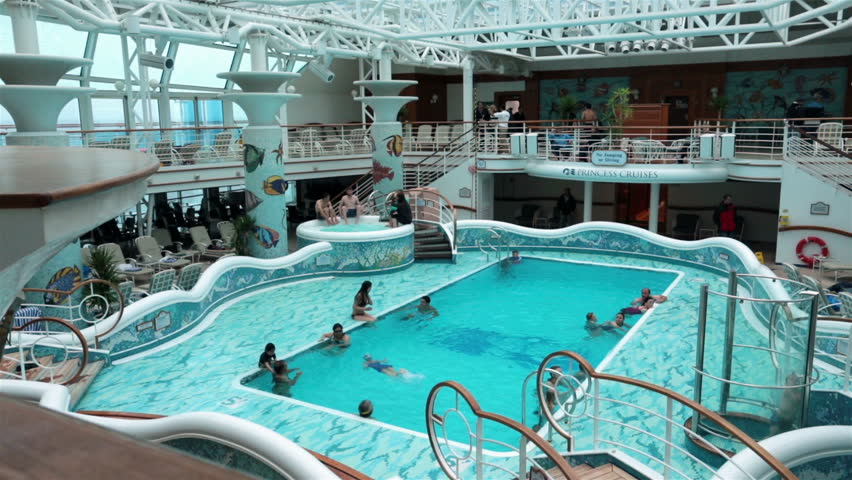 PACIFIC OCEAN, ALASKA MAY 2013: Cruise industry making strong recovery after disasters and bad news. Tourist returning for luxury vacations. Luxury Swimming pool. Inside deck pools and hot tubs.