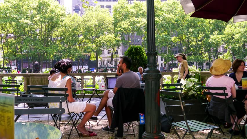"""NEW YORK - JULY 06, 2013: Time Lapse of tourist walking through and around """"The Reading Room"""" in Bryant Park in New York City."""