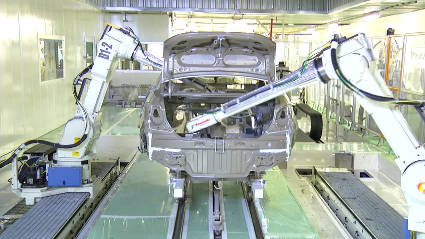 Robots are painting automobile in factory