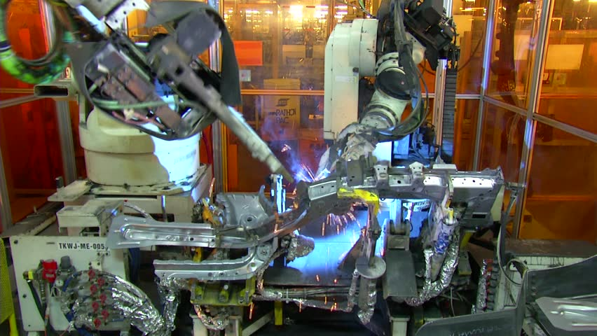 Robots are welding in automobile factory. jib shot.  | Shutterstock HD Video #4203265